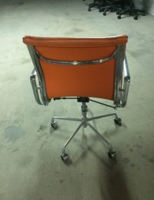 Used Orange Ribbed Eames Style Low Back Chairs